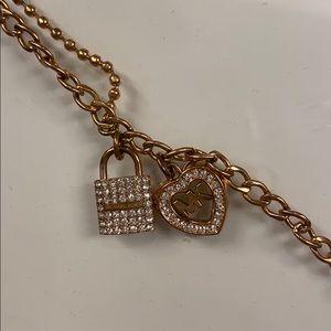 Rose gold Michael Kors lock and heart bracelet